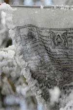 Prayer flag with snow